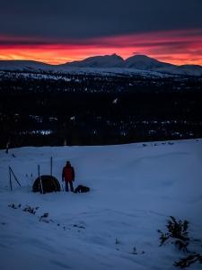 Solnedgång över Rendalssölen, stående. Foto: David Erixon